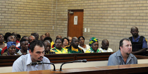 Theo Jackson and Willem Oosthuizen during their bail application hearing at the Middelburg Magistrates Court after they were arrested for allegedly assaulting and forcing Rethabile Victor Mlotshwa into a coffin on December 08, 2016 in Middelburg, South Africa. Jackson and Oosthuizen, who are accused of racism and assault were denied bail.