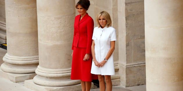 Brigitte Macron, wife of French President Emmanuel Macron, and U.S. First Lady Melania Trump attend a welcoming ceremony at the Invalides in Paris, France, July 13, 2017. REUTERS/Kevin Lamarque