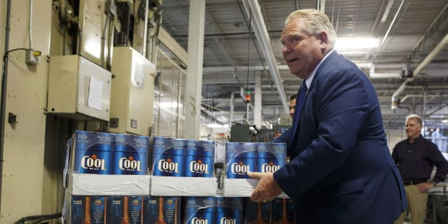 Ontario Premier Doug Ford holds a case of beer during a photo opportunity at a brewery in Etobicoke, Ont. on Aug. 27, 2018.