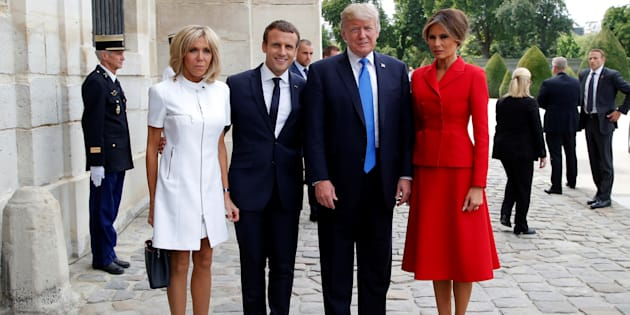 French President Emmanuel Macron (2ndL) and his wife Brigitte (L) pose with U.S. President Donald Trump (2ndR) and First Lady Melania Trump (R) at Les Invalides museum in Paris, France, July 13, 2017.    REUTERS/Michel Euler/Pool