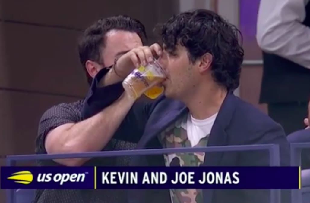 US Open: Joe and Kevin Jonas chug beer, floss on big screen
