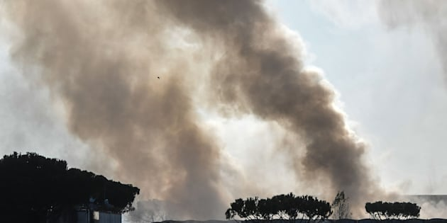 Clouds of smoke erupt after a fire broke out overnight at the TMB Salario mechanical biological waste treatment plant, on December 11, 2018 in Rome. - Twelve teams of firefighters battled Tuesday to put out a vast fire at a garbage dump in Rome as critics slammed the capital's beleaguered waste manager and warned of chaos to come. (Photo by Tiziana FABI / AFP)        (Photo credit should read TIZIANA FABI/AFP/Getty Images)