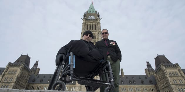 Afghanistan veterans, retired Cpl. Aaron Bedard, right, and retired Major Mark Campbell pose for a photo in Ottawa on Jan. 31, 2018.