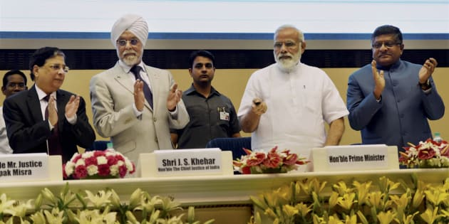 PM Narendra Modi launching the Supreme Court's integrated case management system in New Delhi on 10 May 2017. Chief Justice of India, Justice Jagdish Singh Khehar and Union Law Minister Ravishankar Prasad are also seen.