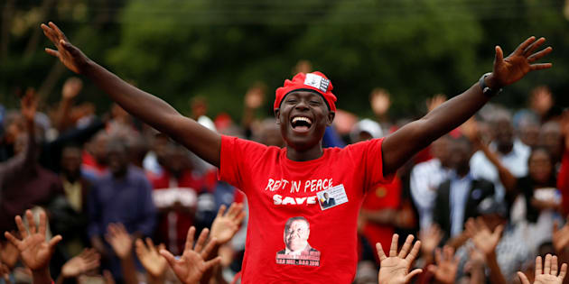 Mourners cheer as the coffin passes at the funeral parade held for the late Movement For Democratic Change (MDC) leader Morgan Tsvangirai in Harare, Zimbabwe February 19, 2018.