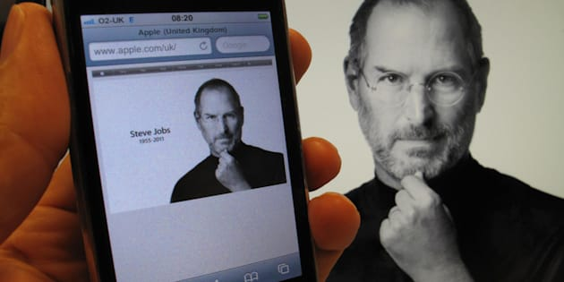 An iPhone and desktop computer display the Apple website's tribute to the company's Steve Jobs, who has died aged 56.