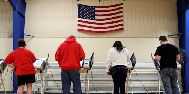 Voters cast their votes during the U.S. presidential election in Elyria, Ohio, U.S. November 8, 2016.