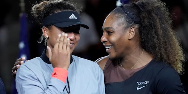 Naomi Osaka of Japan (left) cries as Serena Williams of the USA comforts her after the crowd booed during the trophy ceremony following the women's final on day thirteen of the 2018 U.S. Open.