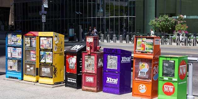 Various newspaper boxes line a street in Toronto. The 2018 Liberal budget pledges $50 million over five years to supporting local journalism in underserved communities. The Liberals will also review funding for journalism in larger cities.