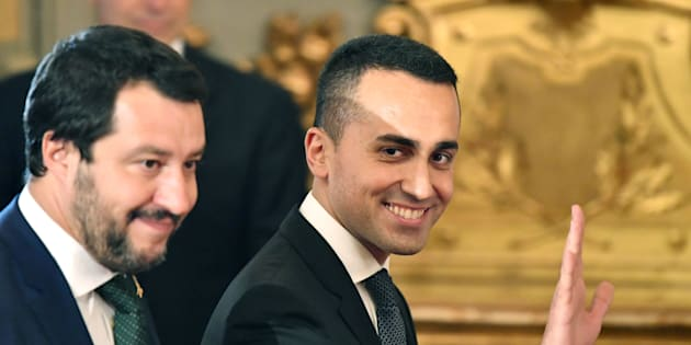 Italys Labor and Industry Minister and deputy PM Luigi Di Maio waves as he arrives with Italys Interior Minister and deputy PM Matteo Salvini for the swearing in ceremony of the new government at Quirinale Palace in Rome