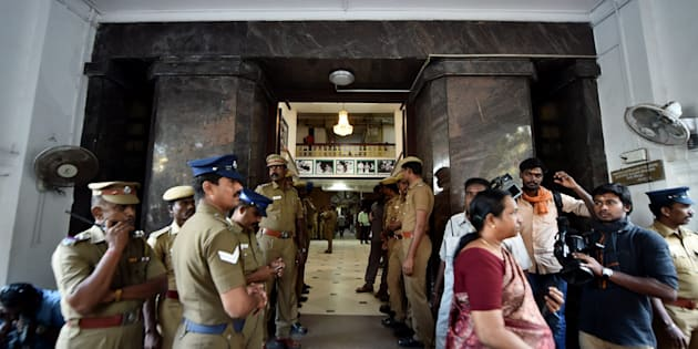 """Police Personnel stands at one of the main entrance of Tamil Nadu State  """"Secretariat""""  during the raid at the chamber of Chief Secretary P Ramamohana Rao, who came under the I-T scanner in Chennai."""