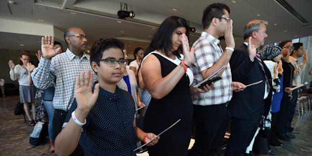 Luiz Capitulino,11, of Brazil joins others in the oath as they become official Canadians during a citizenship ceremony at the National Arts Centre in Ottawa on Monday, Sept. 25, 2017.