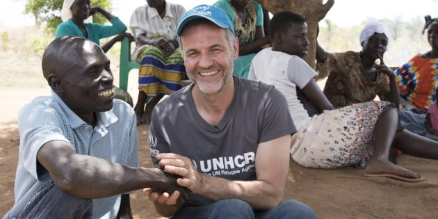 UNHCR Goodwill Ambassador Khaled Hosseini with Yahaya Onduga, a 51-year-old Ugandan farmer who has donated a plot of land to the family of a South Sudanese refugee.
