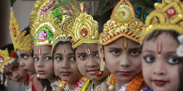 Schoolchildren dressed as Hindu Lord Krishna, wait to perform during the celebrations to mark the Janmashtami festival in Agartala, India, September 5, 2015. The festival, which marks the birth anniversary of Lord Krishna, is being celebrated across the country today. REUTERS/Jayanta Dey