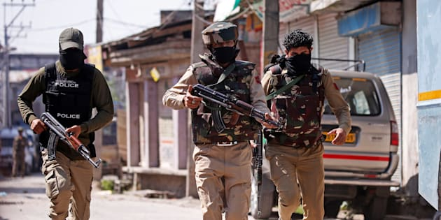 Indian army soldiers patrol a street near a site of a gunbattle between Indian security forces and suspected militants in Srinagar.