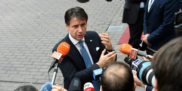 Italy's Prime Minister Giuseppe Conte gestures as he addresses media representatives after an EU - Korea Summit meeting at the European Council in Brussels on October 19, 2018. (Photo by JOHN THYS / AFP)        (Photo credit should read JOHN THYS/AFP/Getty Images)