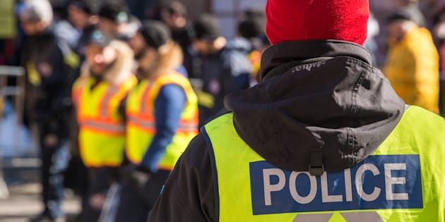 Rear view of a police officer at a parade on March 19, 2017 in Montreal.