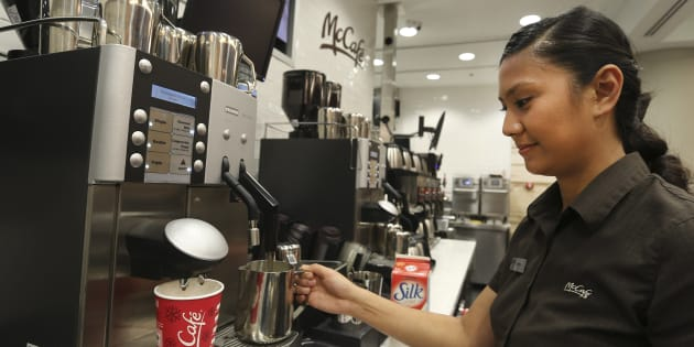 Employee Erika Resulto makes a soy latte at a McCafe outlet in Union Station, Toronto. The Ontario Chamber of Commerce is calling on the provincial government to scrap comprehensive labour laws passed by the previous Liberal government.
