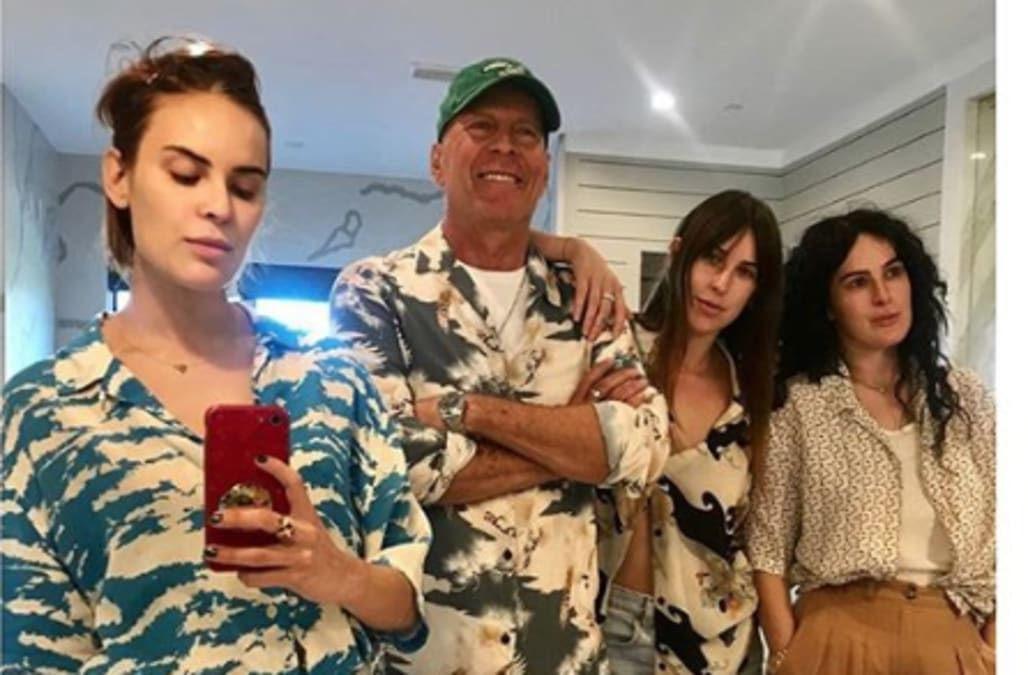 Bruce Willis poses for rare mirror selfie with daughters