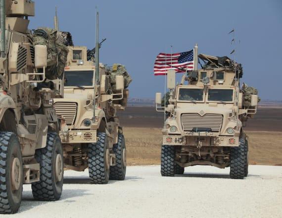 Residents of Syria city pelt departing U.S. troops