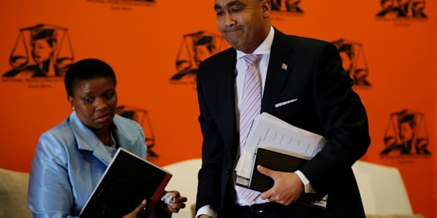 National Director of Public Prosecutions Shaun Abrahams (R) walks past his then deputy Adv Nomgcobo Jiba as he leaves at the end of a media  briefing in Pretoria, South Africa, May 23, 2016.