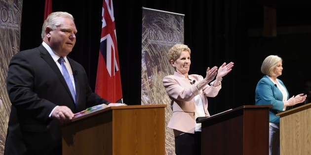 Ontario Progressive Conservative Leader Doug Ford, left to right, Ontario Liberal Leader Kathleen Wynne and Ontario NDP Leader Andrea Horwath applaud as they finish taking part in the second of three leaders' debates in Parry Sound, Ont., on May 11, 2018.