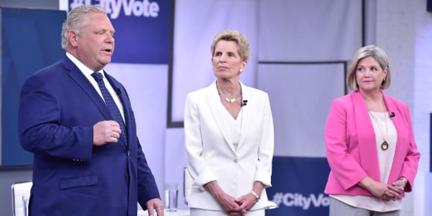 Liberal Premier Kathleen Wynne, centre, Progressive Conservative Leader Doug Ford, left, and NDP Leader Andrea Horwath take part in the Ontario Leaders debate in Toronto on May 7, 2018.