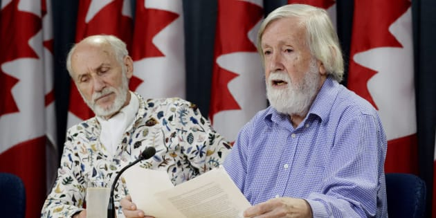 Gilles Provost, left, listens as President of the Canadian Coalition for Nuclear Responsibility Gordon Edwards speaks during a news conference in Ottawa on Aug. 21, 2018.
