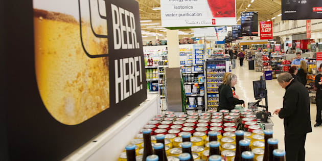 A man buys beer at a Loblaws grocery store in Kingston, Ont., Dec. 16, 2015. With the President's Choice promotion over, it will be pretty difficult to buy beer at the one-dollar price level that Premier Doug Ford made a part of his election platform.