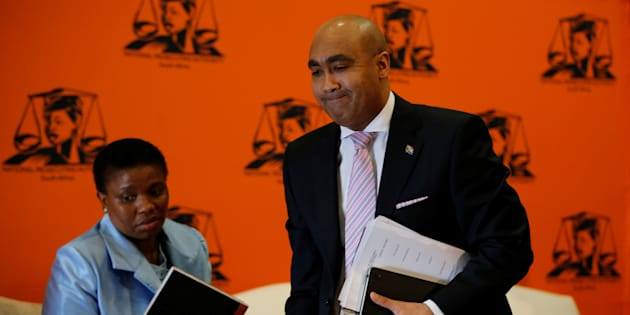 National Director of Public Prosecutions Shaun Abrahams (R) walks past his deputy Adv Nomgcobo Jiba as he leaves at the end of a media briefing in Pretoria, South Africa, May 23, 2016.