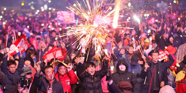 Protesters light fireworks as they celebrate the impeachment of South Korea's ousted leader Park Geun-hye at a rally in Seoul, South Korea, on 11 March, 2017.