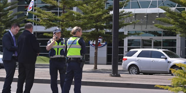Police were shepherding people away from AFL House in Melbourne on Thursday afternoon.