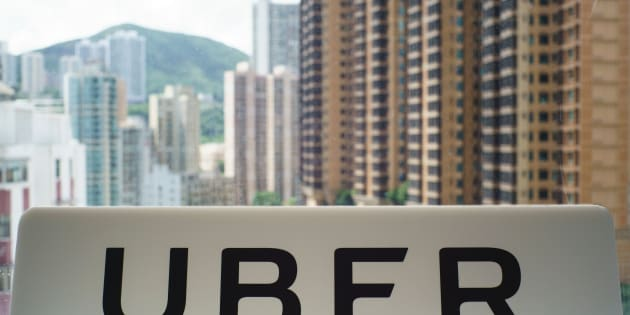 A sign with an Uber logo is seen in the smartphone ride-hailing giant's office in Hong Kong on July 13, 2017. / AFP PHOTO / Aaron TAM        (Photo credit should read AARON TAM/AFP/Getty Images)
