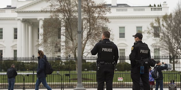 Members of the Secret Service Uniformed Divison patrol alongside the security fence around the perimeter of the White House in Washington, DC, March 18, 2017.  (Photo credit should read SAUL LOEB/AFP/Getty Images)