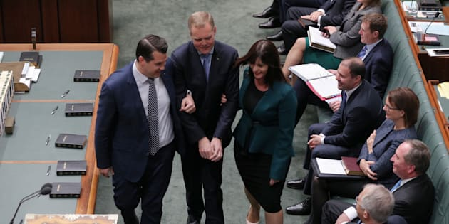 Speaker Tony Smith is dragged to the chair by Michael Sukkar and Lucy Wicks