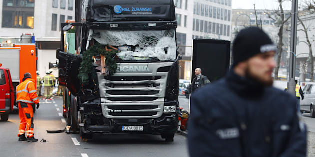 Security and rescue workers tend to the area after a lorry truck ploughed through a Christmas market on December 20, 2016 in Berlin, Germany.