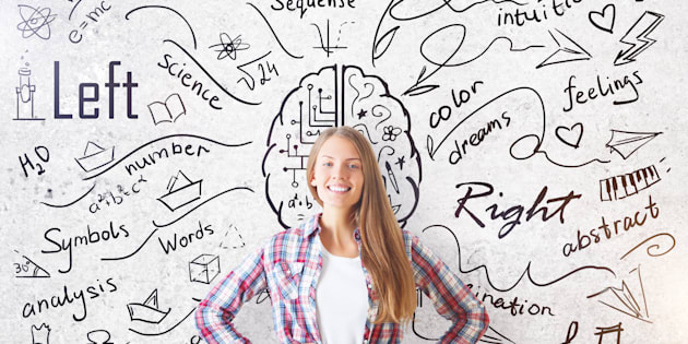 Cheerful young girl on concrete background with creative sketch. Different brain sides concept
