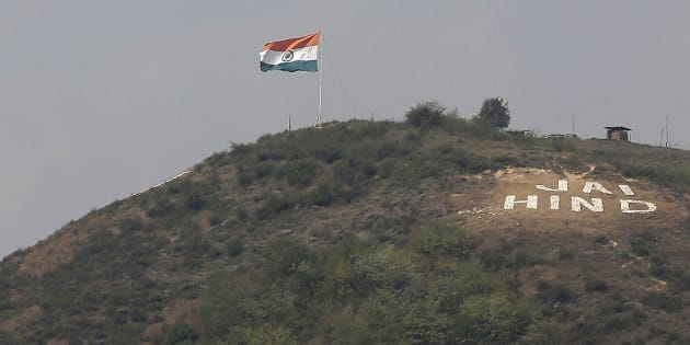 The Indian flag flies on a hill in Uri sector, near the de facto border dividing Kashmir between India and Pakistan, in Indian controlled Kashmir, Wednesday, Sept. 21, 2016. (AP Photo/Mukhtar Khan)