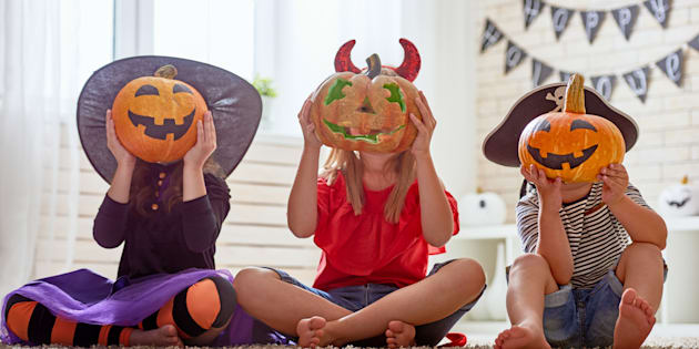 Children playing with Halloween pumpkins.