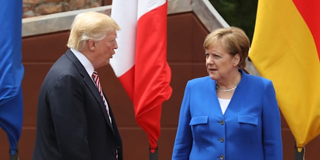 TAORMINA, ITALY - MAY 26:  German Chancellor Angela Merkel and U.S. President Donald Trump arrive for the group photo at the G7 Taormina summit on the island of Sicily on May 26, 2017 in Taormina, Italy. Leaders of the G7 group of nations, which includes the Unted States, Canada, Japan, the United Kingdom, Germany, France and Italy, as well as the European Union, are meeting at Taormina from May 26-27.  (Photo by Sean Gallup/Getty Images)