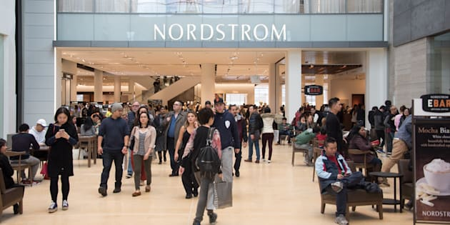 Shoppers at Yorkdale Shopping Centre in Toronto, with a Nordstrom location visible in the background. Fears of job losses following Ontario's minimum wage hike have not come to fruition.