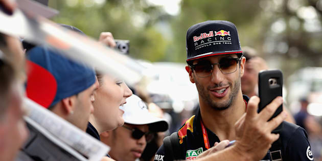 Australia's Daniel Ricciardo poses for a photo with fans ahead of the Australian Formula One Grand Prix at Albert Park.
