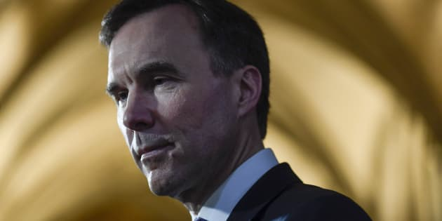 Finance Minister Bill Morneau participates in a TV interview after tabling the budget in the House of Commons on Parliament Hill in Ottawa on Feb. 27, 2018.