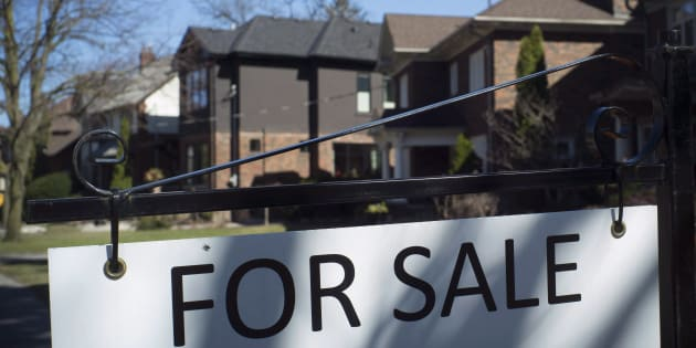 A sold sign is shown in front of west-end Toronto homes Sunday, April 9, 2017. Luxury home sales in the Toronto, Oakville and Hamilton-Burlington areas have fallen by 60 per cent, RE/MAX says.