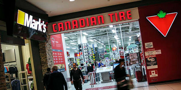 People walk out of a Canadian Tire Store that is located by a Mark's clothing store, which is owned by Canadian Tire Corporation in Toronto, May 8, 2014.