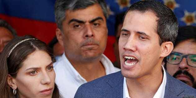 FILE PHOTO: Venezuelan opposition leader Juan Guaido, who many nations have recognized as the country's rightful interim ruler, talks to the media after attending a religious event in Caracas, Venezuela February 10, 2019. REUTERS/Carlos Garcia Rawlins