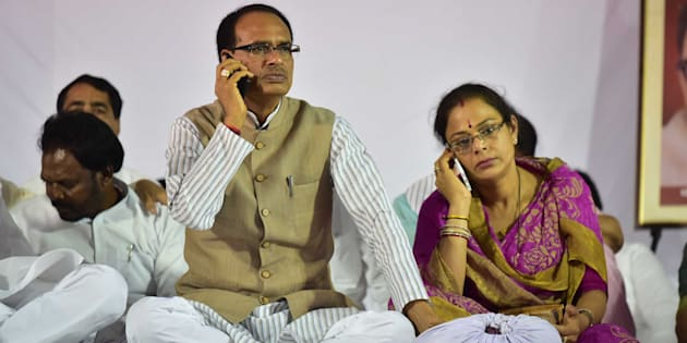 Madhya Pradesh Chief Minister Shivraj Singh Chouhan and his wife Sadhna Singh busy with their cell phones during indefinite fast, on June 11, 2017 in Bhopal.