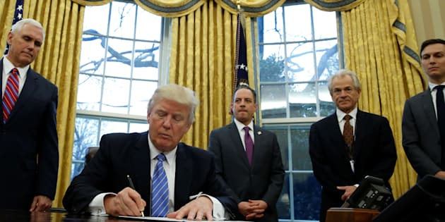 POTUS Donald Trump joined by men, signs an order to reinstate Reagan's  'Global Gag Rule' which bars international health organisations that receive U.S. funding from mentioning abortion as a family planning option. REUTERS/Kevin Lamarque