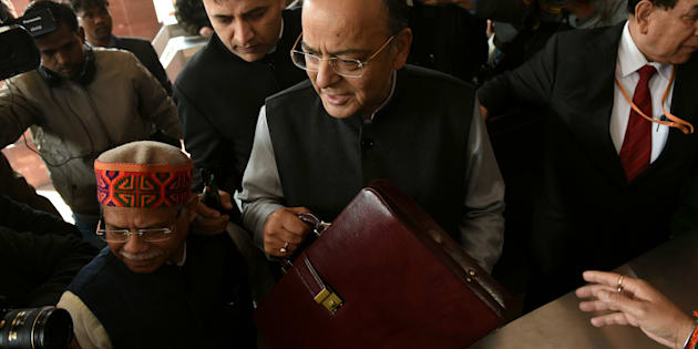 Indian Finance Minister Arun Jaitley (C) arrives at Parliament House to present the Union Budget in New Delhi on February 1, 2018.