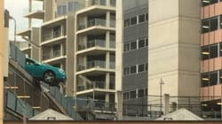 Bizarre Pictures Emerge Of Car Hanging Over Edge Of Brisbane Hospital